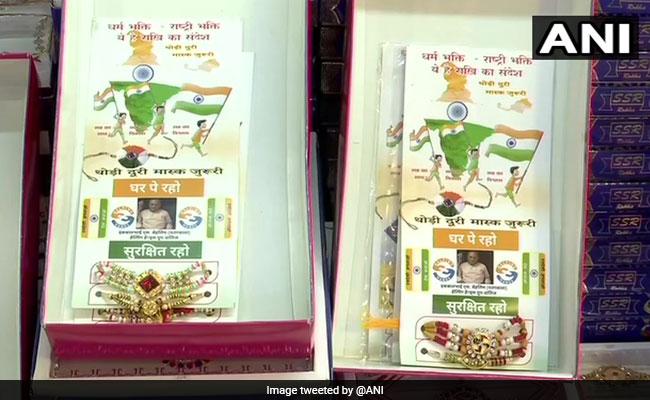 Raksha Bandhan 2020: Pedagang Gujarat Menjual Rakhis Dengan COVID-19 Kutipan Pencegahan: Kenakan Masker