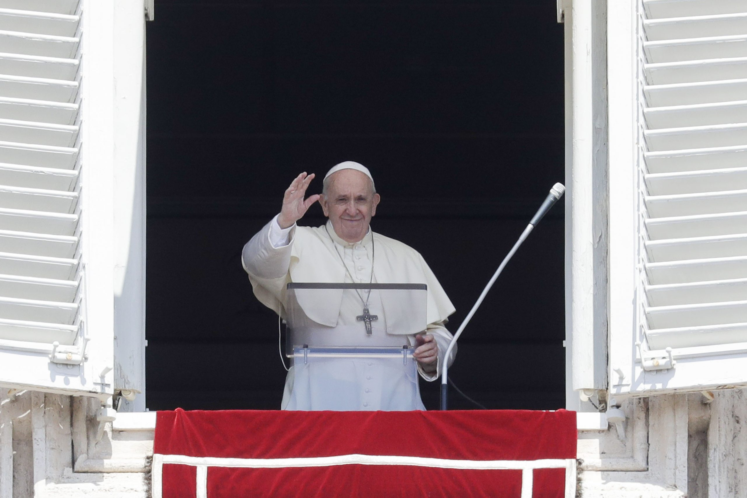 Pope Francis is pictured on August 15, as he delivers his blessing from the window of his studio overlooking St. Peter's Square, at the Vatican.