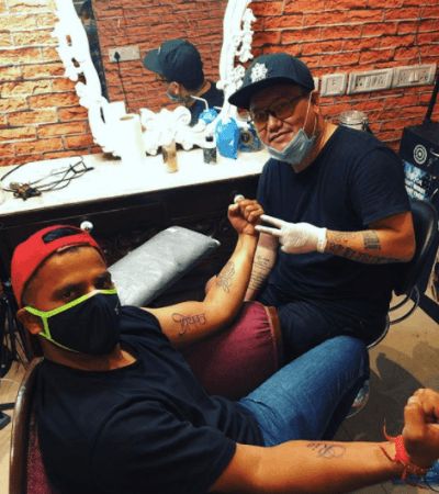 Suresh Raina membuat tato